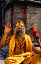 L-12-1278-sadhu_sitting_on_a_stone_chaitya_on_the_eastern_banks_of_the_bagmati_river__pashupatinath__nepal-Z000TNAC.jpg