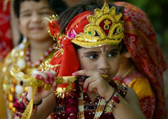L-16-1659-a_child_enacts_the_life_of_hindu_god_krishna_during_janamashtami_celebrations-Z00DGLY5.jpg